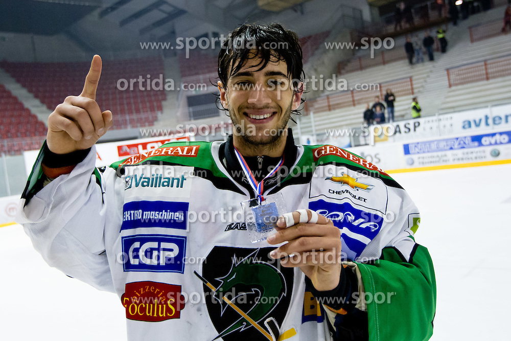 Matija Pintaric (HDD Tilia Olimpija, #69) after ice-hockey match between HK Acroni Jesenice and HDD Tilia Olimpija in fourth game of Final at Slovenian National League, on April 2, 2012 at Dvorana Podmezaklja, Jesenice, Slovenia. HDD Tilia Olimpija won 5:2 and become national champions in season 2011/12. (Photo By Matic Klansek Velej / Sportida.com)