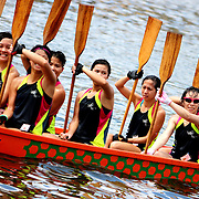 Team, Hong Kong by Jem.<br /> <br /> One of the few all-female dragon boating teams, in Shing Mun River, Sha Tin, Hong Kong during the annual Dragon Boat Festival.  <br /> <br /> Jem Guanzon, from the Philippines joined Lensational in May 2013. Alongside her job as a domestic worker, she earns extra income as an event photographer for the Embassy of the Philippines in Moscow, Russia, and through selling photos via Lensational.