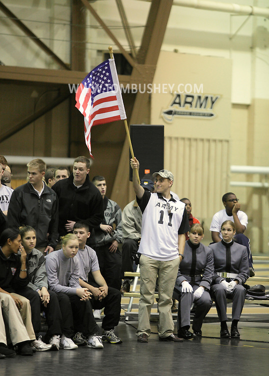 West Point, NY - An Army fan waves the American flag before his team plays Lehigh in the Patriot League women's volleyball tournament at the United States Military Academy on  Nov. 21, 2009.