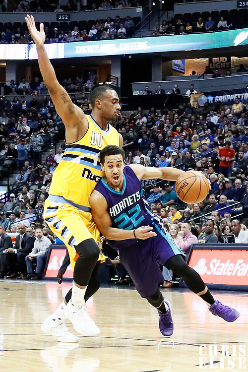 04 March 2017: Charlotte Hornets guard Brian Roberts (22) drives past Denver Nuggets forward Darrell Arthur (00) during the Charlotte Hornets 112-102 victory over the Denver Nuggets, at the Pepsi Center, Denver, Colorado, USA.