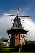 The corn mill in Roden  built in 1893. In 1936 the windmill is bought by a dairy/grain factory 'De Goede verwachting' <br /> <br /> De Korenmolen in Roden. Een achtkante bovenkuier met stelling gebouwd in 1893. In 1936 aangekocht door zuivelfabriek en graanmaalderij 'De Goede verwachting'