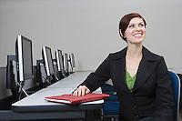 Cheerful Businesswoman Sitting at Desk