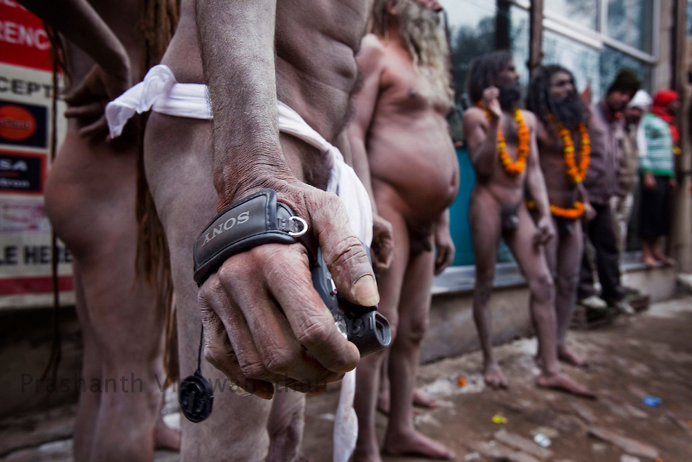 "A Naga sadhu holds a Sony video camera during the ""Shayi Snan"" (royal bath) during he Maha Kumbh ceremony in Haridwar, February 12, 2010.  Photographer:Prashanth Vishwanathan"