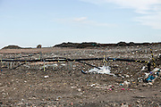 Landfill site. Methane gas is collected via pipes reaching deep into the landfill site and piped into a compressor house to be converted into electricity. Packington, Warwickshire, UK. 2011
