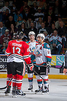 KELOWNA, CANADA - APRIL 19: Damon Severson #7 and Tyrell Goulbourne #12 of the Kelowna Rockets get in the face of Keegan Iverson #13 of the Portland Winterhawks on April 18, 2014 during Game 2 of the third round of WHL Playoffs at Prospera Place in Kelowna, British Columbia, Canada.   (Photo by Marissa Baecker/Shoot the Breeze)  *** Local Caption *** Keegan Iverson; Damon Severson; Tyrell Goulbourne;