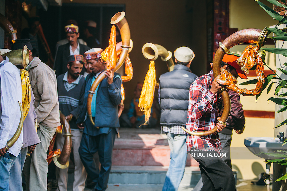 Traditional Himachali musicians removing theirs shoes as they enter the temple. Kullu Dussehra is the Dussehra festival observed in the month of October in Himachal Pradesh state in northern India. It is celebrated in the Dhalpur maidan in the Kullu valley. Dussehra at Kullu commences on the tenth day of the rising moon, i.e. on 'Vijay Dashmi' day itself and continues for seven days. Its history dates back to the 17th century when local King Jagat Singh installed an idol of Raghunath on his throne as a mark of penance. After this, god Raghunath was declared as the ruling deity of the Valley.