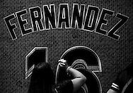 As many wait in line, a fan signs a tribute wall honoring Jose Fernandez outside Marlins Park.