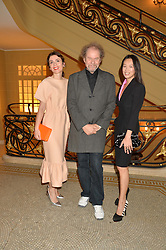 Left to right, LARA BOHINC, MIKE FIGGIS and ROSEY CHAN at the Sindika Dokolo Art Foundation Dinner held at The Cafe Royal, Regent Street, London on 18th October 2014.