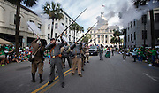 Members of the Sons of Confederate Veterans fire a volley during the 191st St. Patrick's Day parade, Tuesday, March 17, 2015, in Savannah, Ga. (AP Photo/Stephen B. Morton)