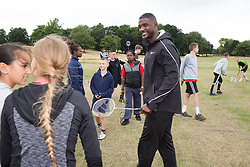 © Licensed to London News Pictures. 28/7/2016. Birmingham, UK.  More than 150 athletes, officials and staff representing USA Track & Field (USATF) are staying in Birmingham at the end of July, ahead of the IAAF World Championships in London. Pictured, USA track star Justin Gatlin joined local Birmingham children taking part in a sports event at a nearby park. Photo credit: Dave Warren/LNP