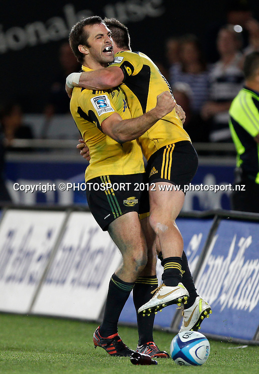 Conrad Smith of the Hurricanes celebrates scoring the winning try during the Super Rugby game between The Blues and The Hurricanes at Eden Park, Auckland New Zealand, Friday 23 March 2012. Photo: Simon Watts / photosport.co.nz