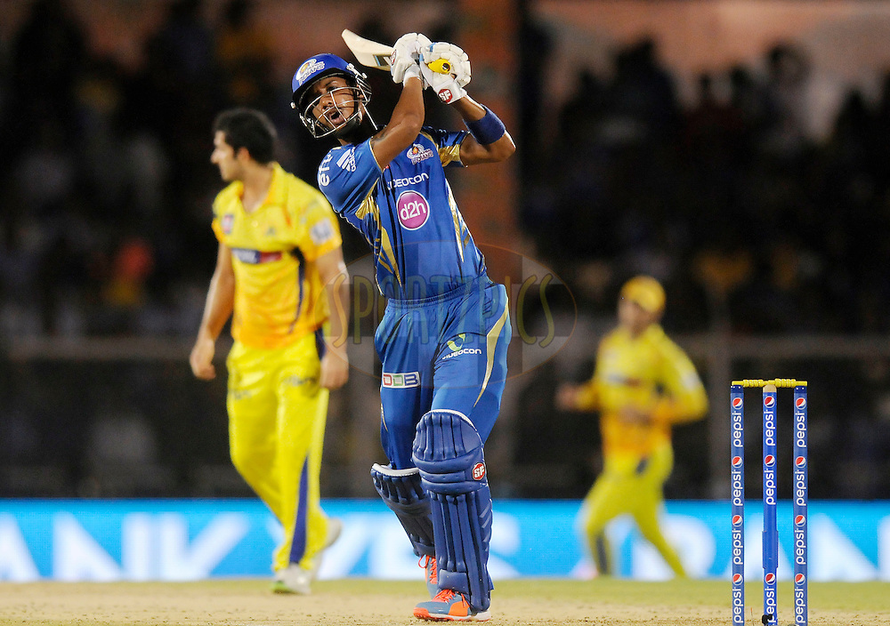 Lendl Simmons of Mumbai Indians swings his bat in dejection as Mohit Sharma of The Chennai Superkings stops  a ball of his own bowling during the eliminator match of the Pepsi Indian Premier League Season 2014 between the Chennai Superkings and the Mumbai Indians held at the Brabourne Stadium, Mumbai, India on the 28th May  2014<br /> <br /> Photo by Pal PIllai / IPL / SPORTZPICS<br /> <br /> <br /> <br /> Image use subject to terms and conditions which can be found here:  http://sportzpics.photoshelter.com/gallery/Pepsi-IPL-Image-terms-and-conditions/G00004VW1IVJ.gB0/C0000TScjhBM6ikg