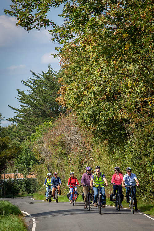 A group of cyclists ride along a country road in Staplehurst, Kent, England, UK.  They are riding electric bikes. (photo by Andrew Aitchison / In pictures via Getty Images)