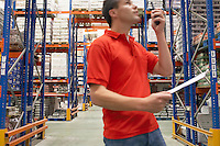 Warehouse Worker Using Walkie-Talkie