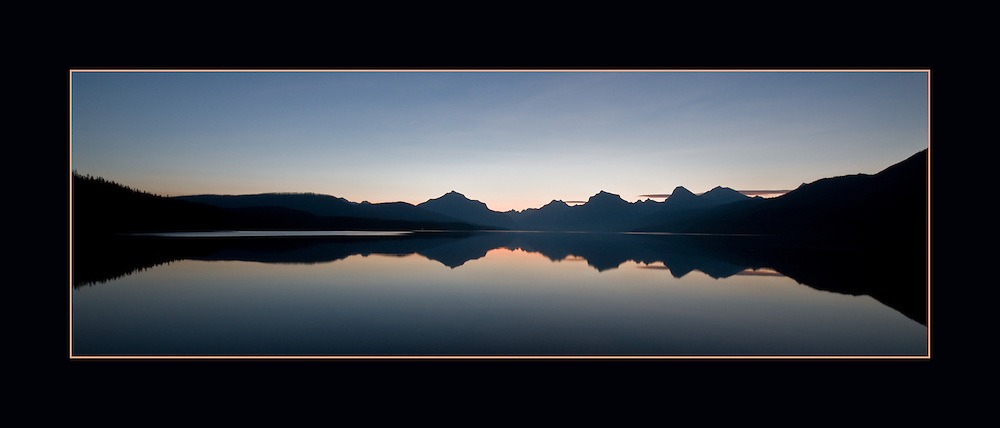 Predawn on Lake McDonald with wide-angle lens and perfect reflections.