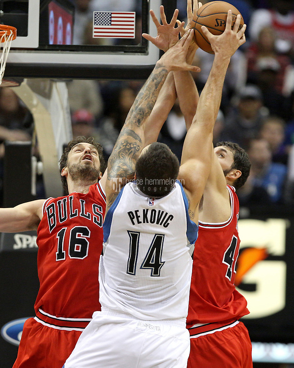 Nov 1, 2014; Minneapolis, MN, USA; Minnesota Timberwolves center Nikola Pekovic (14) gets his shot blocked by Chicago Bulls forward Pau Gasol (16) and forward Nikola Mirotic (44) during the second quarter at Target Center. Mandatory Credit: Brace Hemmelgarn-USA TODAY Sports