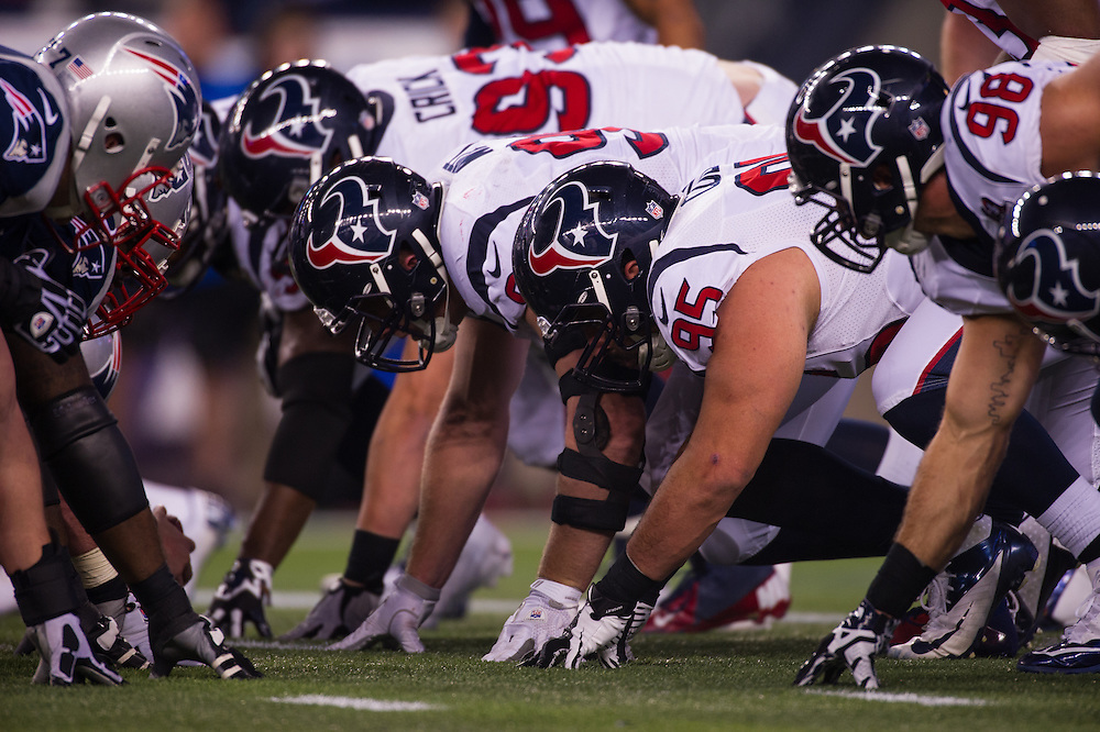 FOXBORO, MA - JANUARY 13:  A general view of the line of scrimmage during the AFC Divisional Playoff between the New England Patriots and the Houston Texans at Gillette Stadium on January 13, 2013 in Foxboro, Massachusetts.(Photo by Rob Tringali) *** Local Caption ***