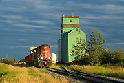 Old grain elevators with train on the Canadian Prairie<br /> Sexsmith<br /> Alberta<br /> Canada