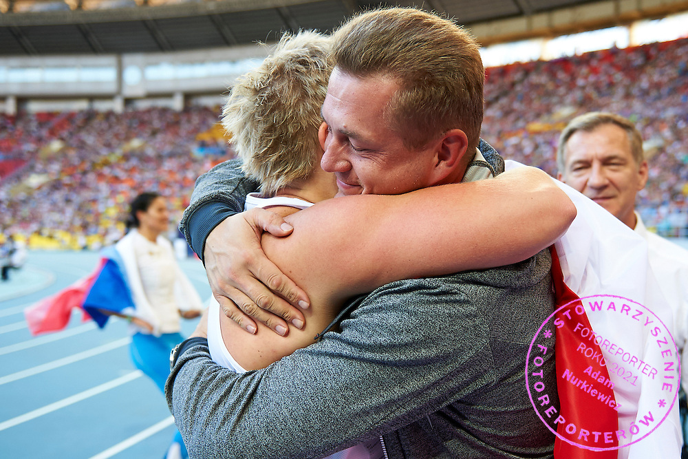Trainer coach Krzysztof Kaliszewski (R) congratulates to Anita Wlodarczyk (L) while women's hammer throw competition during the 14th IAAF World Athletics Championships at the Luzhniki stadium in Moscow on August 16, 2013.<br /> <br /> Russian Federation, Moscow, August 16, 2013<br /> <br /> Picture also available in RAW (NEF) or TIFF format on special request.<br /> <br /> For editorial use only. Any commercial or promotional use requires permission.<br /> <br /> Mandatory credit:<br /> Photo by &copy; Adam Nurkiewicz / Mediasport