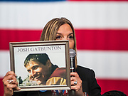 10 AUGUST 2019 - DES MOINES, IOWA: KIM GATBUNTON holds up a photo of her son, Josh Gatbunton, who was murdered with a gun in 2008. Kim Gatbunton was one of the people at the Moms Demand Action event who asked Democratic presidential candidates a question about gun safety laws. Several thousand people from as far away as Milwaukee, WI, and Chicago, came to Des Moines Saturday for the Presidential Gun Sense Forum. Most of the Democratic candidates for president attended the event, which was organized by Moms Demand Action, Every Town for Gun Safety, and Students Demand Action.          PHOTO BY JACK KURTZ