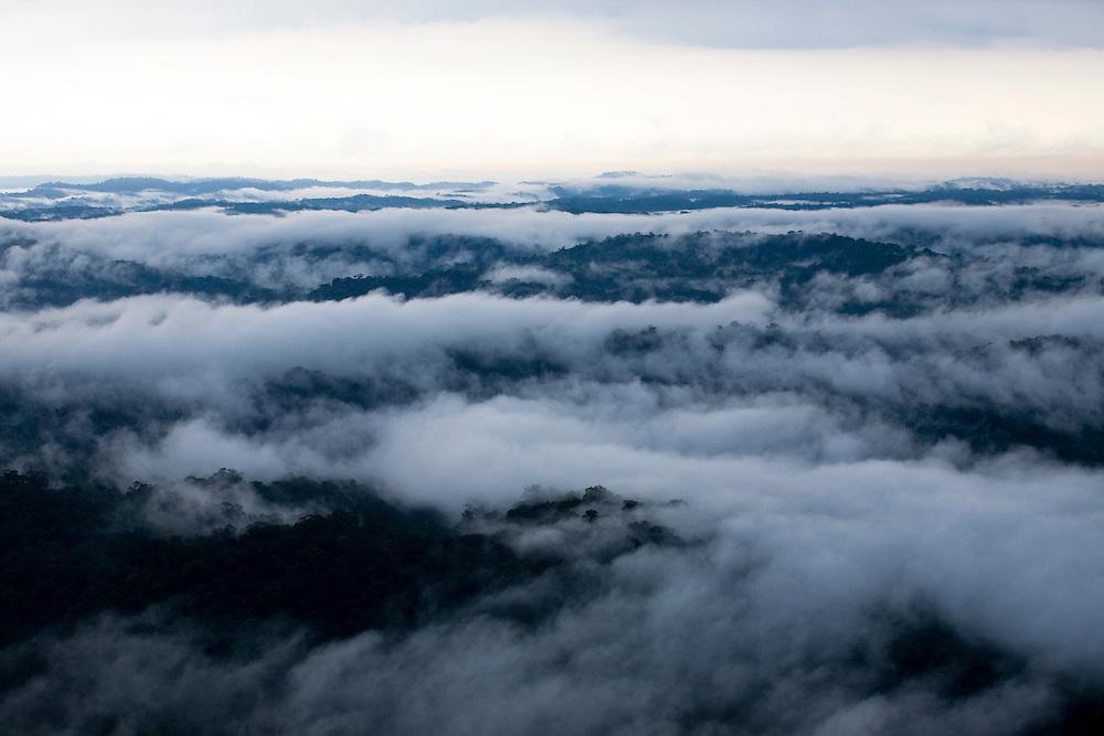 Rain and evaporation over the rainforest. Flight SW of Santarem on Trairao Municipality..Daniel Beltra/Greenpeace