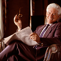 Environmental portrait of a business man reading the Wall Street Journal.  Original captured on film in 1996.