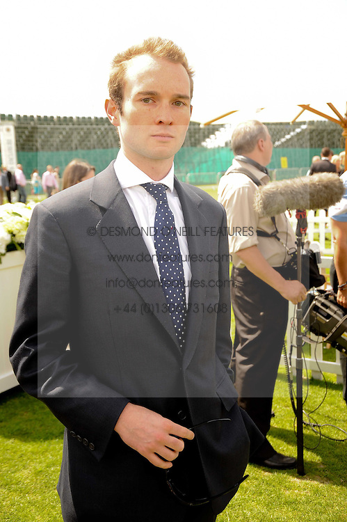 LORD ELCHO son and heir of 13th Earl of Wemyss at the Cartier International Polo at Guards Polo Club, Windsor Great Park, Berkshire on 25th July 2010.