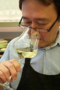Vienna, Austria. Kiang Winebar.<br /> Joseph Kiang tasting Wine.