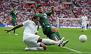 Glen Johnson and Bojan Jokic during the international friendly match between England and Slovenia at Wembley Stadium, London on the 5th September 2009
