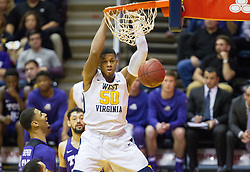 Jan 7, 2017; Morgantown, WV, USA; West Virginia Mountaineers forward Sagaba Konate (50) dunks the ball during the first half against the TCU Horned Frogs at WVU Coliseum. Mandatory Credit: Ben Queen-USA TODAY Sports