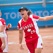 Women's softball finals-USA vs. Canada- Jenna Caira-Canada (black hat) cheers as Canada scores a run in extra innings during competition at the 2015 PanAm Games in Toronto.