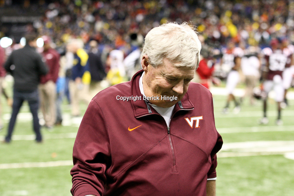 January 3, 2012; New Orleans, LA, USA; Virginia Tech Hokies head coach Frank Beamer walks off the field following a loss to the Michigan Wolverines in the Sugar Bowl at the Mercedes-Benz Superdome. Michigan defeated Virginia 23-20 in overtime. Mandatory Credit: Derick E. Hingle-US PRESSWIRE
