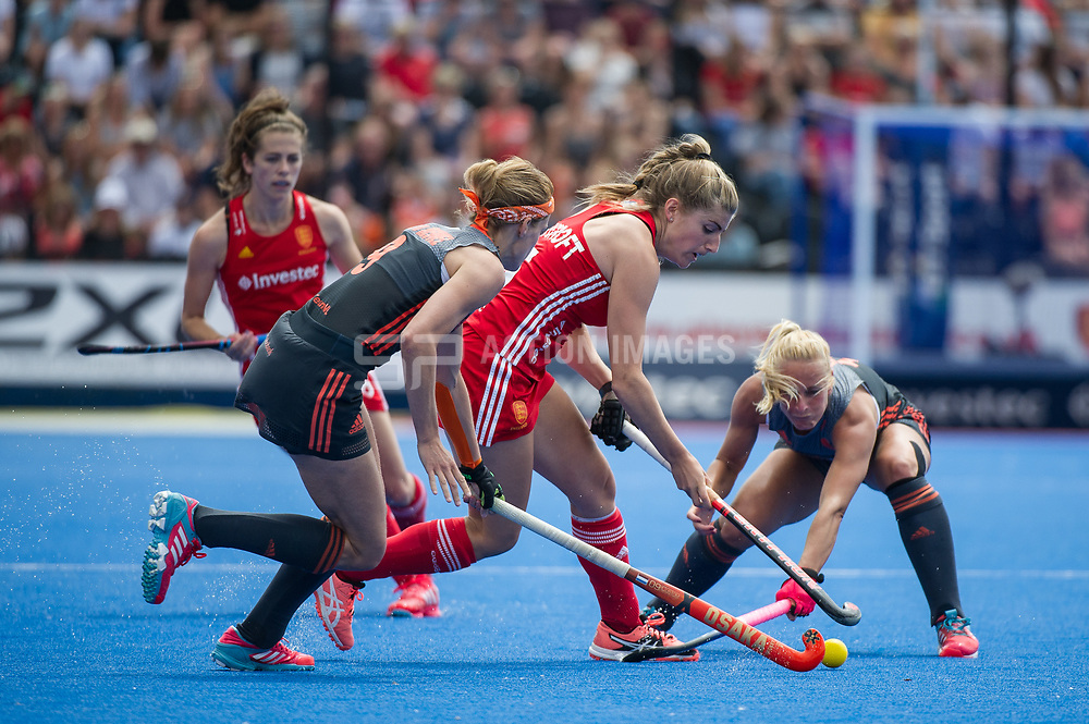England's Sarah Haycroft is watched by Carlien Dirkse van den Heuvel of the The Netherlands. England v The Netherlands, Lee Valley Hockey and Tennis Centre, London, England on 11 June 2017. Photo: Simon Parker