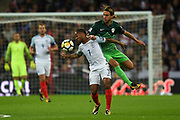 England midfielder Raheem Sterling and Slovenia midfielder Rene Krhin  during the FIFA World Cup Qualifier match between England and Slovenia at Wembley Stadium, London, England on 5 October 2017. Photo by Martin Cole.