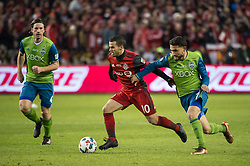 December 9, 2017 - Toronto, Ontario, Canada - Toronto FC forward SEBASTIAN GIOVINCO (10) dribbles past Seattle Sounders midfielder CRISTIAN ROLDAN (7) while chased by Seattle Sounders defender GUSTAV SVENSSON (4) during the MLS Cup championship match at BMO Field in Toronto, Canada.  Toronto FC defeats Seattle Sounders 2 to 0. (Credit Image: © Mark Smith via ZUMA Wire)