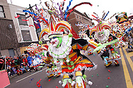 PHILADELPHIA - JANUARY 1:   Members of the Greater Kensington String Band perform as they march up Broad Street during the 105th Annual Mummers Parade January 1, 2006 in Philadelphia. Thousands lined the three mile parade route to watch Philadelphia's colorful New Years Day tradition, which dates back to 1900. (Photo by William Thomas Cain/Getty Images)