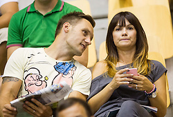 Luka Zvizej with his wife during friendly match between National teams of Slovenia and Latvia for Eurobasket 2013 on August 2, 2013 in Arena Zlatorog, Celje, Slovenia. (Photo by Vid Ponikvar / Sportida.com)