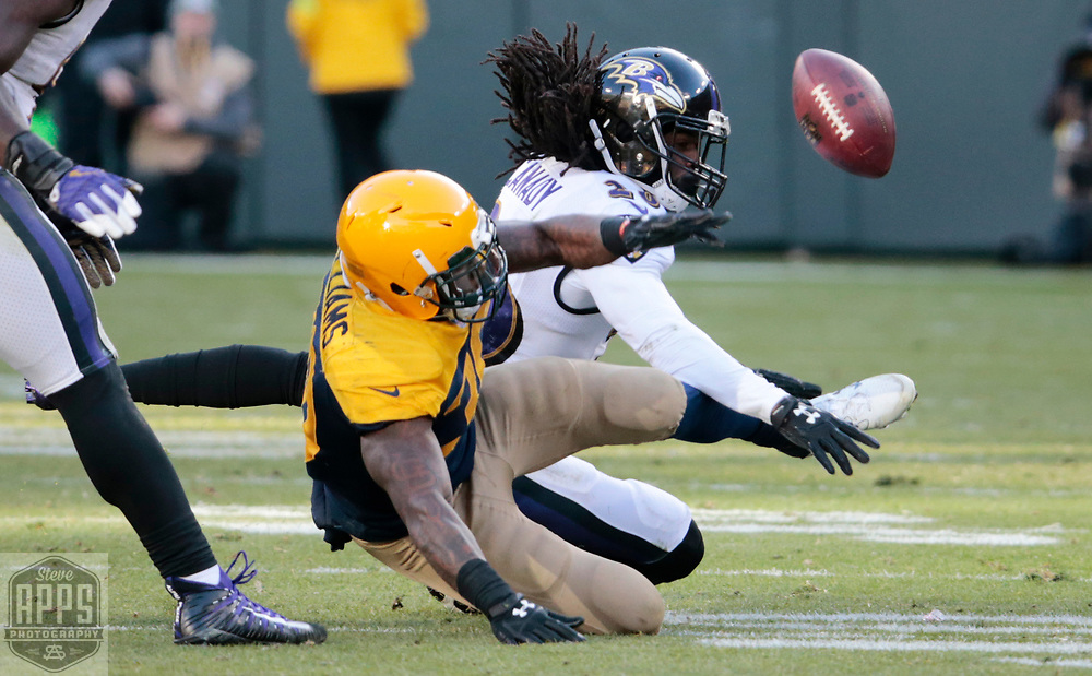 Green Bay Packers running back Jamaal Williams (30) and Baltimore Ravens cornerback Maurice Canady (26) trying to recover a fumble by Green Bay Packers quarterback Brett Hundley (7) in the 4th quarter. <br /> The Green Bay Packers hosted the Baltimore Ravens at Lambeau Field Sunday, Nov. 19, 2017. The Packers lost 23-0. STEVE APPS FOR THE STATE JOURNAL.