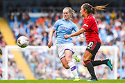 Manchester City Women midfielder Keira Walsh (24) and Manchester United Women midfielder Katie Zelem (10) during the FA Women's Super League match between Manchester City Women and Manchester United Women at the Sport City Academy Stadium, Manchester, United Kingdom on 7 September 2019.