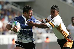 Paul Bosch makes a break for the try line and is stopped by Whaleed Hynes during the Festival of Rugby match between The Boland Cavaliers and The Stormers held at The Cape Town Stadium (formerly Green Point Stadium) in Cape Town, South Africa on 6 February 2010.  This is the first match/event to be held at the new stadium which was purpose built to host matches during the FIFA World Cup South Africa 2010.Photo by: Ron Gaunt/SPORTZPICS