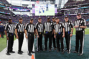 NFL officials pose for a photograph on the field before the Philadelphia Eagles 2018 NFL Super Bowl LII football game against the New England Patriots on Sunday, Feb. 4, 2018 in Minneapolis. The Eagles won the game 41-33. (©Paul Anthony Spinelli)