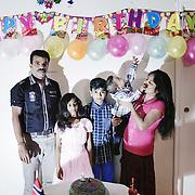 The family posing for a picture on Kavinash 1st birthday. From the left: Mathan, Mathumika (7), Kavisan (10), Kavinash (1) and Chandrakala.