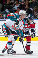 KELOWNA, CANADA - MARCH 27: Rourke Chartier #14 of Kelowna Rockets checks Lucas Nickles #9 of Tri-City Americans after the face off on March 27, 2015 at Prospera Place in Kelowna, British Columbia, Canada.  (Photo by Marissa Baecker/Shoot the Breeze)  *** Local Caption *** Lucas Nickles; Rourke Chartier;