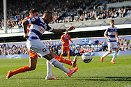 Queens Park Rangers Danny Simpson is challenged by Blackpool's Chris Basham .Skybet football league championship match , Queens Park Rangers v Blackpool at Loftus Road in London  on Saturday 29th March 2014.<br /> pic by John Fletcher, Andrew Orchard sports photography.