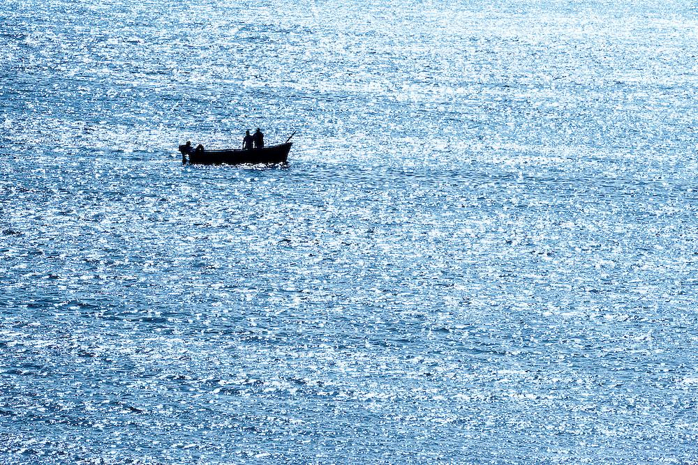 Fishing boat in the sea at Lac Naila (Lagoon Khenifiss), Morocco.