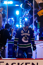 June 4, 2011; Vancouver, BC, CANADA; Vancouver Canucks left wing Daniel Sedin (front) and center Henrik Sedin (back) enter the ice before game two of the 2011 Stanley Cup Finals against the Boston Bruins at Rogers Arena. Vancouver defeated Boston 3-2 in overtime. Mandatory Credit: Jason O. Watson / US PRESSWIRE
