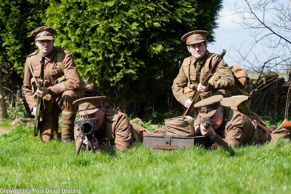 Renactors portraying the Cheshire Regiment of the first world war undertake training behind the Elm Tree Pub before they take part in a reenactment in Elmton in June..Ed Wilson gives covering fire with his Lee Enfield Rifle while Peter Austeridge and Stuart Oden-Walder (right) change the drum magazine on a Lewis machine gun<br /> 20 April  2013.Image &copy; Paul David Drabble