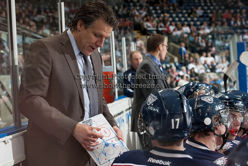 KELOWNA, CANADA - MARCH 23: Jim Hiller, head coach of the Tri-City Americans goes over a play on the bench opposite the Kelowna Rockets on March 23, 2014 during game 2 of the first round of WHL Playoffs at Prospera Place in Kelowna, British Columbia, Canada.   (Photo by Marissa Baecker/Getty Images)  *** Local Caption *** Jim Hiller;