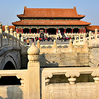 History of Emperors at Forbidden City in Beijing, China<br /> In 1402, when Zhu Di became Yongle Emperor, the third ruler of the Ming dynasty, he moved the capital city from Nanjing to Beiping (today&rsquo;s Beijing) and began building the Forbidden City in 1406. Construction by one million laborers required 14 years. 13 additional Ming emperors occupied Zijin Cheng (Purple Forbidden City) until Chongzhen Emperor was overthrown in 1644 and committed suicide. After a brief occupation by the Shun dynasty, the Imperial Chinese Dragon Throne was captured by Manchus forces and Shunzhi Emperor was declared the new ruler of China at the age of six. 10 Qing dynasty emperors and their government resided at the Forbidden City for 268 years, interrupted twice by occupation of foreign troops. In 1912, the imperial dynasty was defeated during the Xinhai Revolution (Chinese Revolution of 1911), marking the beginning of the Republic of China. Puyi, China&rsquo;s last emperor, was allowed to remain in the Inner Court until 1924. The following year, it became the Palace Museum. The photo shows two of the five Inner Golden Water Bridges with the Gate of Supreme Harmony in the background.