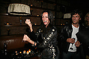 TRISHA SIMONON AND BARRY REIGATE, Lucy Yeomans Editor of Harper's Bazaar and Moet and Chandon host the Gold Party. 17 Berkeley St. London W1. 1 November 2007. -DO NOT ARCHIVE-© Copyright Photograph by Dafydd Jones. 248 Clapham Rd. London SW9 0PZ. Tel 0207 820 0771. www.dafjones.com.
